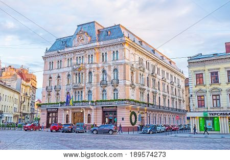 LVOV UKRAINE - MAY 16 2017: The square of Adam Mickiewicz with historic building of Hotel George in warm sunset light on May 16 in Lvov.