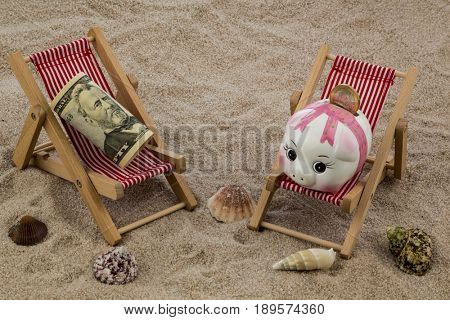 deckchair with piggy bank and dollars
