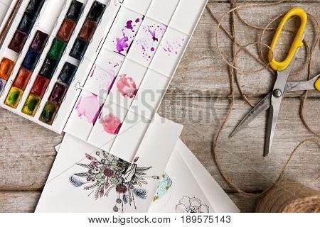 Sketch of bouquet. Decorator workplace, tools top view. Florist workshop with decor. Decorative creative artwork , paint, succulent