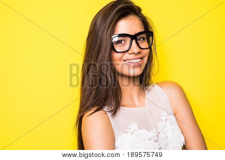 Portrait Of A Stunning Woman Posing Over Yellow Background.