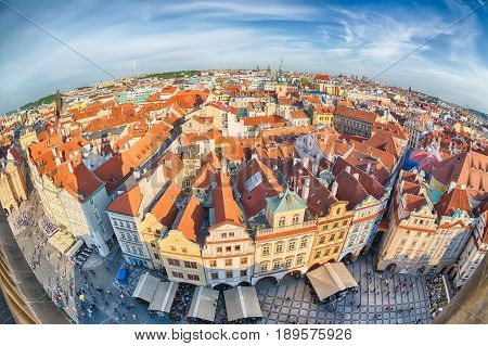 Houses with traditional red roofs in Prague Old Town Square in the Czech Republic. Fish-eye lens.