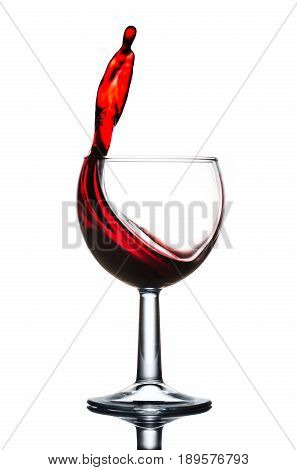 Elegant pure wineglass with wave of brightly red wine isolated on white background.