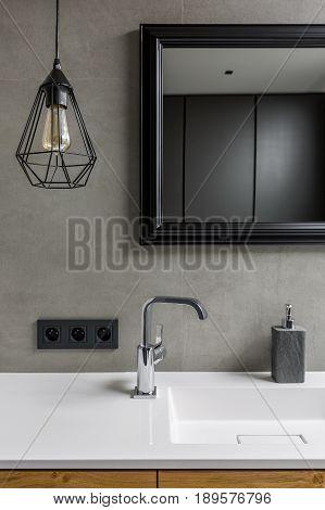Gray Bathroom With Mirror
