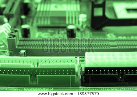 Close-up Of Electronic Circuit Board With Processor Toned.