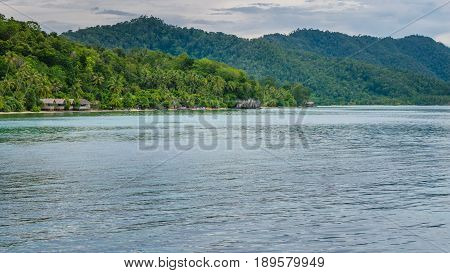 Homestay on Kri Island, Monsuar in Background, Raja Ampat, Indonesia, Papua