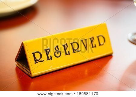 A Sign On The Reserved Table In The Restaurant.