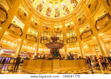 Macau, China - December 8, 2016: Lobby of The Venetian Luxury Resort and Casino in Cotai Strip. Interior of elegant and gold decorated entrance. The Venetian Macao is the largest casino in the world.