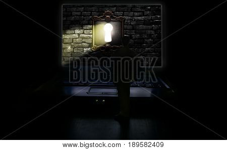 Miniature human figure standing in front of a computer screen with keyhole light shining through