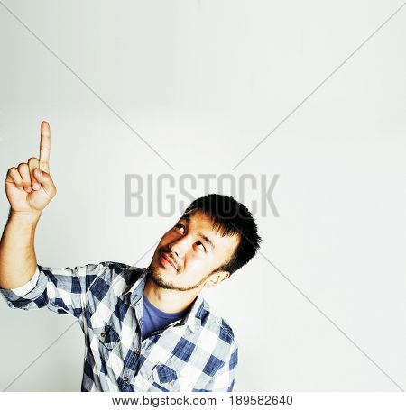 young cute asian man on white background gesturing emotional, pointing, smiling, lifestyle people concept, cheerfull mature guy making funy faces close up