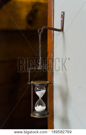 antique hourglass on an old sailboat used for navigation