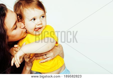 pretty real normal mother with cute blond little daughter close up isolated on white background, lifestyle real people concept