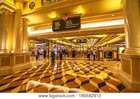 Macau, China - December 8, 2016: inside of The Venetian Resort and Casino. Golden corridor and entrance of popular Casino. The Venetian Macao is modeled on its sister casino The Venetian Las Vegas