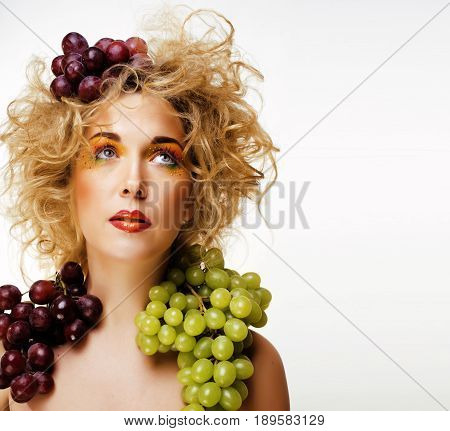beautiful young woman portrait excited smile with fantasy art hair makeup style, fashion girl with creative food fruit orange, grapes, citrus make up, happy looking at camera cheerful
