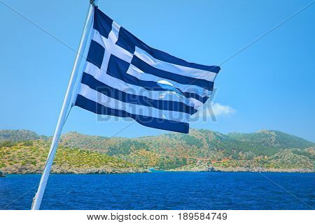Greece flag consists of colors blue and white straps and white cross - symbol of blue sea and white sea scum or sky. Greece national flag. Greece holidays vacations tours