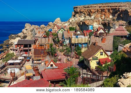 Traditional colorful houses in the famous Popeye Village at Anchor Bay, Il-Mellieha, Malta