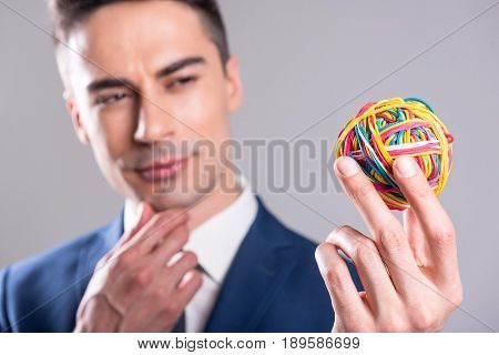Focus on hand of man keeping rubber sphere. He dreaming while watching on it. Inspiration concept