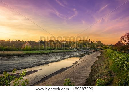 Sunset over the river Rother at low tide, Rye, East Sussex, England