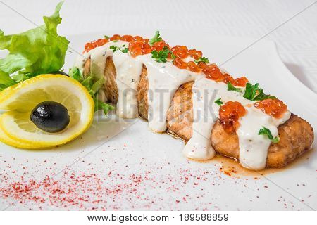 Delicious Salmon With Sauce, Red Caviar, Lemon And Herbs. Horizontal Frame