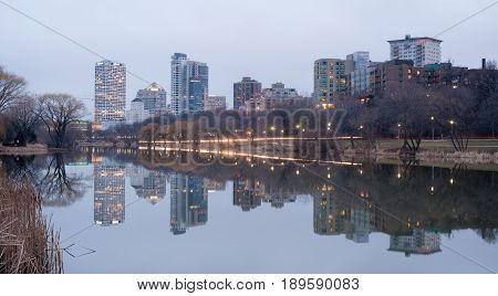 MILWAUKEE WISCONSIN/UNITED STATES - APRIL 1: Most of the cities residents sleep as the sun comes up on the downtown waterfront from Veteran's Park on 03/30/2017 in Milwaukee WI.