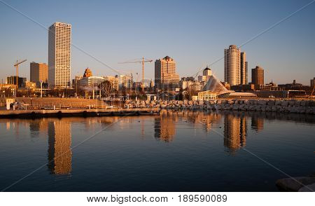 MILWAUKEE WISCONSIN/UNITED STATES - APRIL 1: Most of the cities residents sleep as the sun comes up on the downtown waterfront on 04/01/2017 in Milwaukee WI.