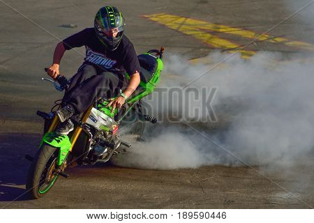 Moscow Russia - June 7 2015: Stunt motorcycle rider performing at a local spot.