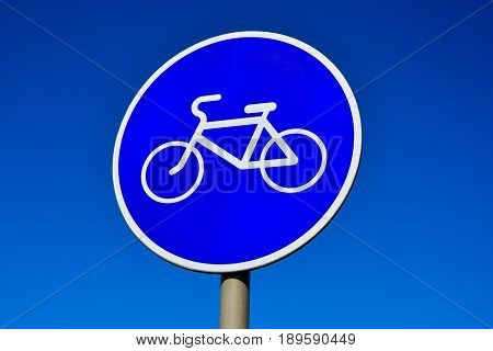 Bicycle road sign on a blue sky background