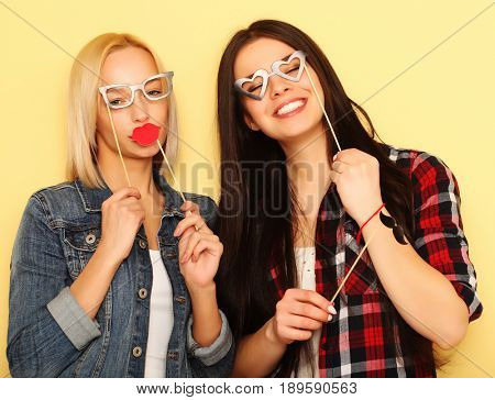 Stylish sexy hipster girls best friends ready for party.Over ye
