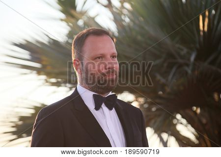 Yorgos Lanthimos winner of the award for Best Screenplay  attends the Palme D'Or Winner Photocall during the 70th annual Cannes Film Festival at Palais on May 28, 2017 in Cannes, France.