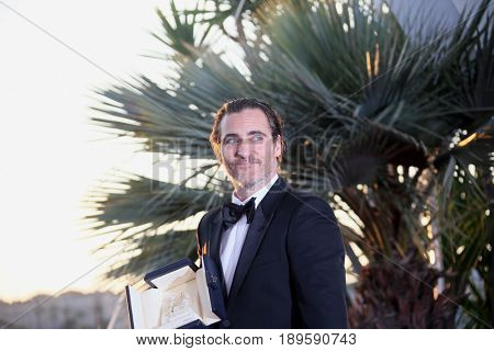 Joaquin Phoenix, who won the award for Best Actor  at the Palme D'Or winner photocall during the 70th Cannes Film Festival at Palais  on May 28, 2017 in Cannes, France.