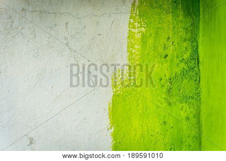 unfinished painted paint wall with green color and white photo taken in jakarta indonesia java
