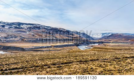 View of the Mountains and Thompson River Valley on a cold winter day from Juniper Beach Provincial Park in the Thompson River Valley between Kamloops and Cache Creek in central British Columbia