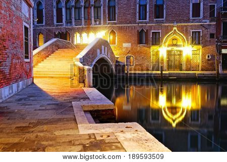 Venice, Italy, May, 31, 2017: night landscape with the image of bridge over a channel in Venice, Italy