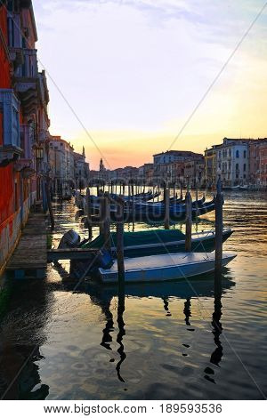 Venice, Italy, May, 31, 2017: landscape with the image of boats on a channel at in Venice, Italy