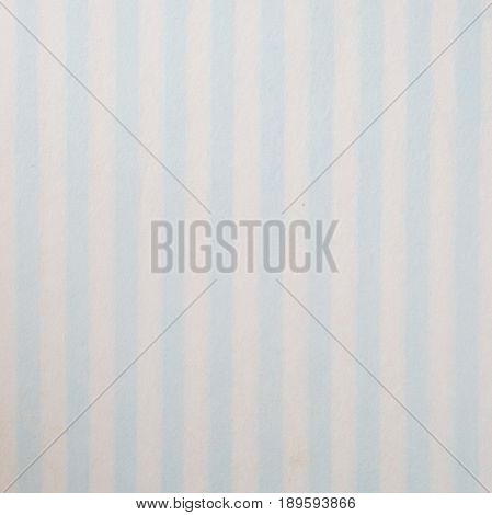 Blue and white striped pattern on mulberry paper textured background detail close-up