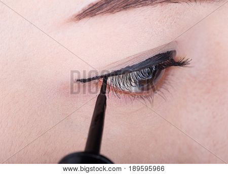 close-up of woman make-up with black eyeliner