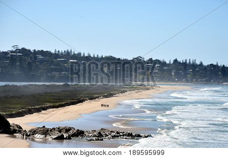 People walking on the beach at Blackfellows Point. Potato Point is a village in the Eurobodalla Shire lying on the south coast of NSW Australia.