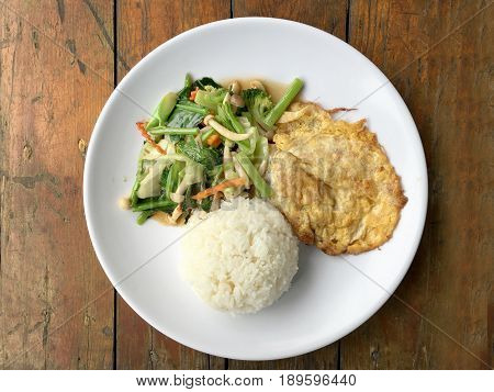 Stir Fried Vegetables With Thai Omelette (scrambled Eggs) With Rice In White Plate On Rustic Wooden