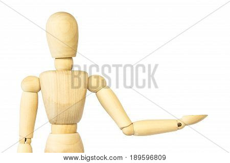 Wooden puppet is presenting something . Blank area at left side for fill your product . Isolated background .