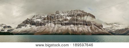 Bow Lake panorama with snow capped mountain and forest in Banff National Park