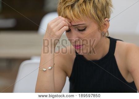 Worried Young Woman With A Tension Headache