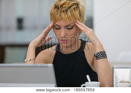 Attractive Stylish Young Woman With A Headache