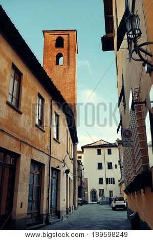 Lucca street view with bell tower in Italy