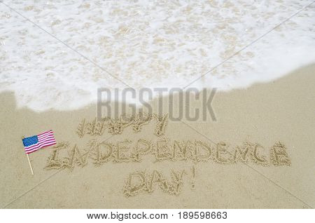 Independence USA background with American flag on the sandy beach near ocean
