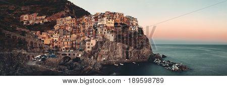Manarola overlook Mediterranean Sea panorama with buildings over cliff in Cinque Terre, Italy.