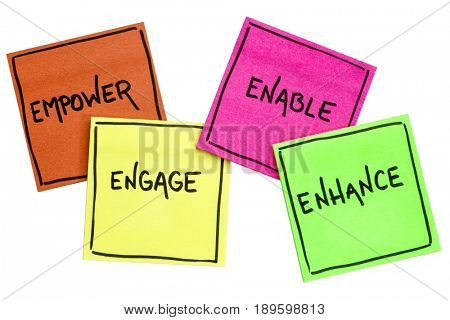 empower, engage, enable, and enhance inspirational concept - handwriting on isolated sticky notes