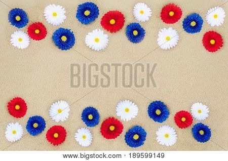 Patriotic USA background with flowers decorations on the sandy beach
