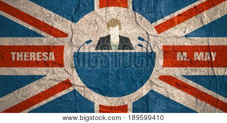 United Kingdom - April, 2017: A illustration of a woman icon and the Prime Minister of the United Kingdom Theresa May name. Flag of the Great Britain on backdrop. Concrete grunge texture
