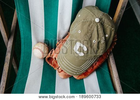 Baseball cap of captain, ball and leather catcher's glove