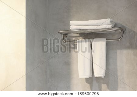 white bath towels on towel rack in bathroom