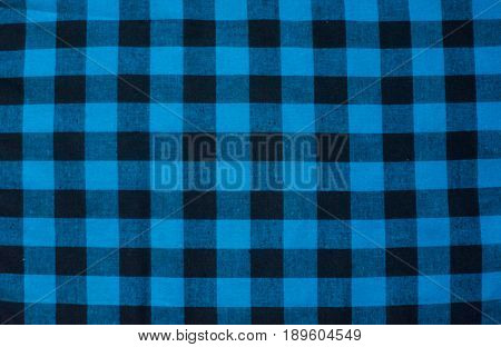Blue-black Cloth In A Cage In The Background